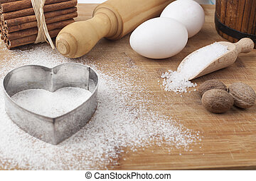 Bakery - Baking ingredients and tools on brown wood cutting...