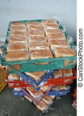 Bakery bread - Rows of bread loaves in racks in a bakery