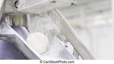 bakery conveyor production. dough moves along the conveyor...