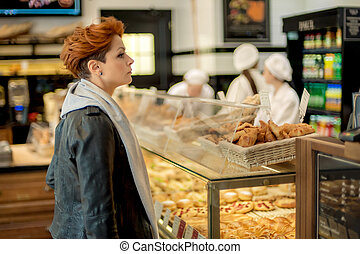 Bakery Item - Woman choosing bakery items in a shop