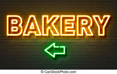Bakery neon sign on brick wall background.