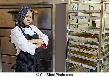 bakery shop owner female muslim chef