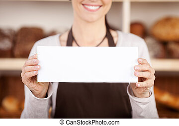 Bakery worker holding up a blank sign - Bakery worker ...
