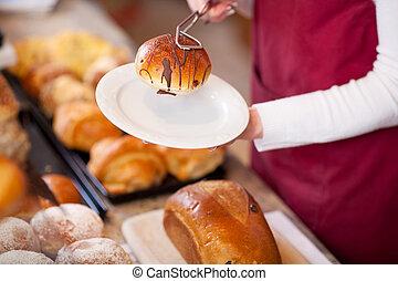 Bakery Worker Keeping Bread In Plate