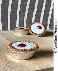 bakewell tarts in front of zebra striped wall