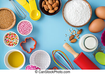 Baking background with ingredients and utensils with space in the middle