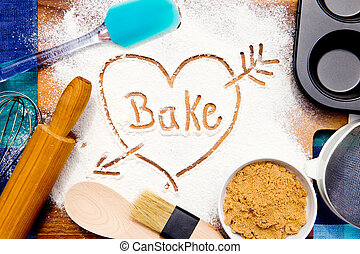Baking - Bake with Heart - written in flour