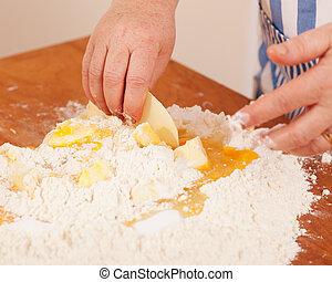 Baking biscuits - Woman mixes dough - Baking biscuits, woman...