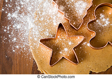 Baking christmas cookies with star and tree motif