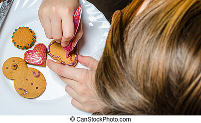 Cutting and baking Christmas gingerbread in Advent Time