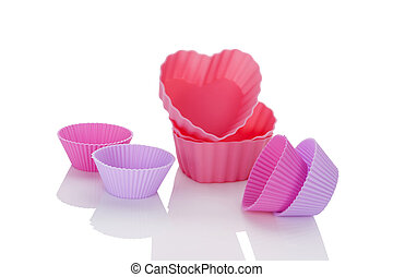 Baking forms. - Pink and purple baking forms isolated on...