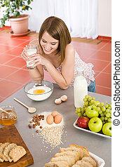 Baking - Happy woman prepare healthy ingredients for organic...