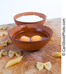 Baking ingedients. pasta on table with eggs