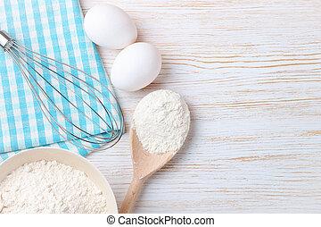 Baking ingredients on white wooden background