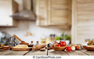 Baking ingredients placed on wooden table, ready for cooking...