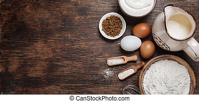 Traditional baking ingredients. Rustic background with free text space.
