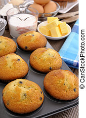 Baking ingredients with fresh muffins