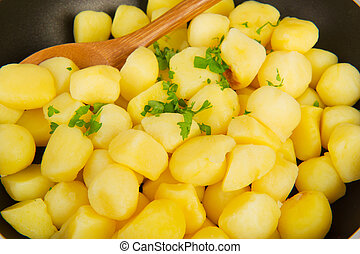 Baking new potatoes with fresh parsley herbs