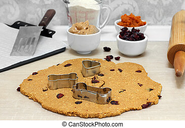 Baking peanut butter, pumpkin, oat and cranberry dog biscuits.