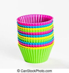 baking silicone cups for cupcakes or muffins on white background