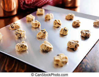 baking tray full of formed dough for chocolate chip cookies