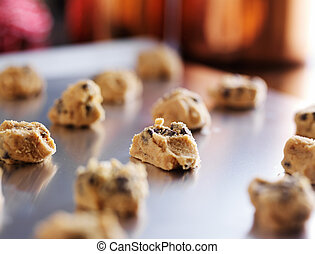 baking tray with uncooked chocolate cookie dough formed into balls