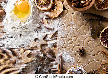 Baking utensils, spices and food ingredients on wooden ...