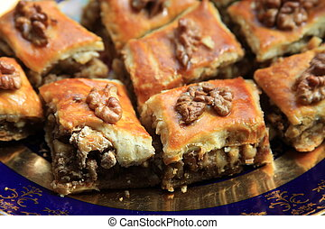 Close up of a baklava on a plate.
