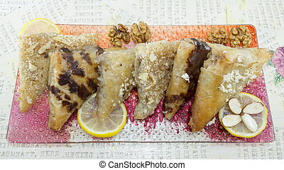 Baklava decorated with nuts, lemon and almonds