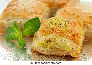 Fresh baklava served on a typical Moroccan tray