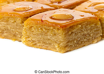 Baklava with almonds on white background. Macro with extremely shallow dof. Selective focus.