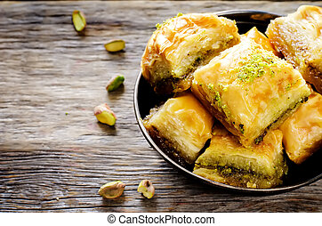 baklava with pistachio. turkish traditional delight on a ...