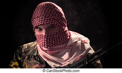 Balaclava angry terrorist with machine gun threat