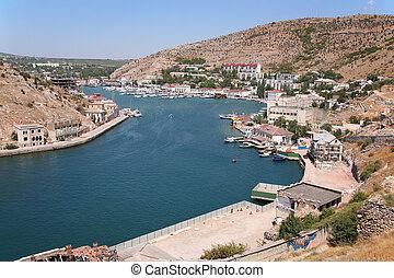 Balaklava City at coast of the bay.