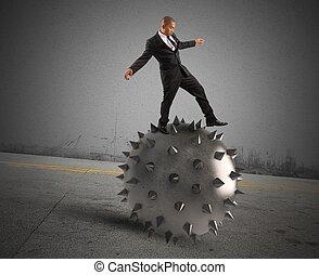 Balance crisis - Man keeps the balance despite the crisis