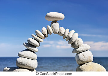 Balance in Air - White stones are formed as an arc of the...