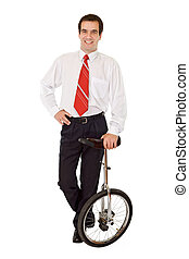 Balance in business - businessman with monocycle - Balance...