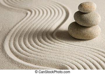 Balance - Stack of stones on raked sand; zen concept
