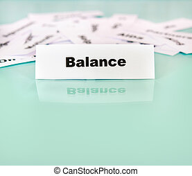 Balance - Piece of paper with balance word,sign or text on...