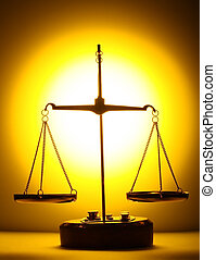Balance - scales on yellow light background