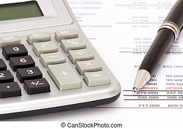 Balance sheet - Selective focus on calculator, biro and...