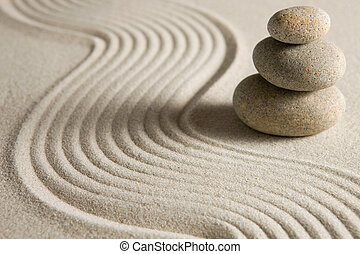Balance - Stack of stones on raked sand; zen concept