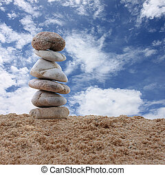Balance stone on sand.
