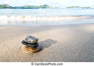 Balance stone on the beach