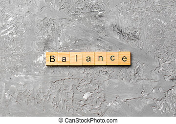 balance word written on wood block. balance text on cement table for your desing, concept