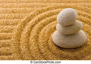Balance - Zen garden. Macro of three staked stones on raked...