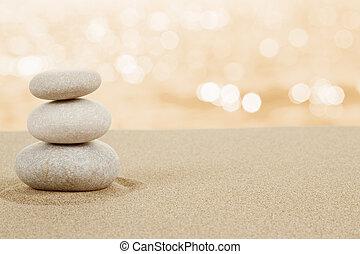 Balance zen stones in sand on white background