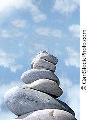 balanced cloudy rocks