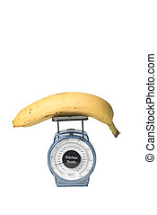 Balanced diet - banana on a kitchen scale to illustrate...