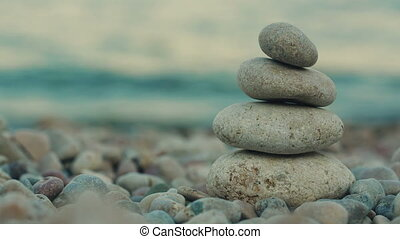 Balanced Spa Stones on a Background of the Sea
